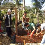 Toilet construction workwith international volunteer in chogaun